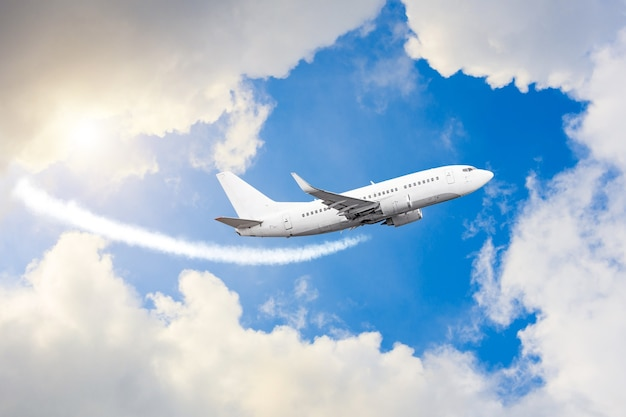 Airplane flies in sky, a journey through the clouds and a sunny glare.