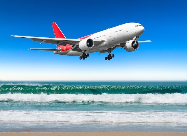 Airplane flying over amazing ocean landscape with tropical island, travel destinations.