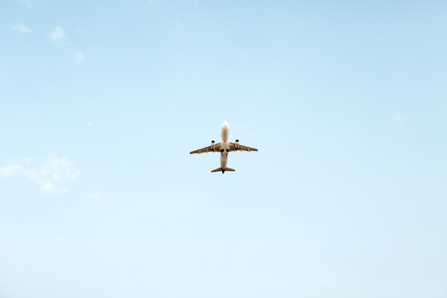 Airplane flying in blue sky. travel, vacation and holiday concept.