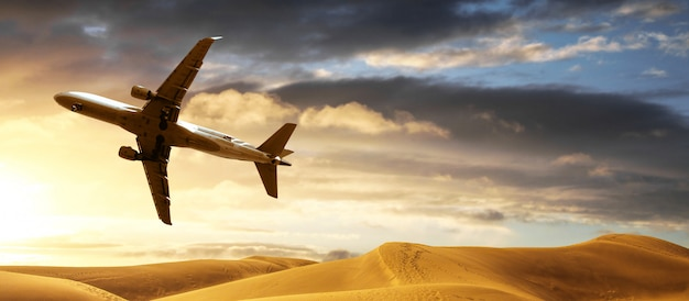 Airplane flying over the desert at low altitude