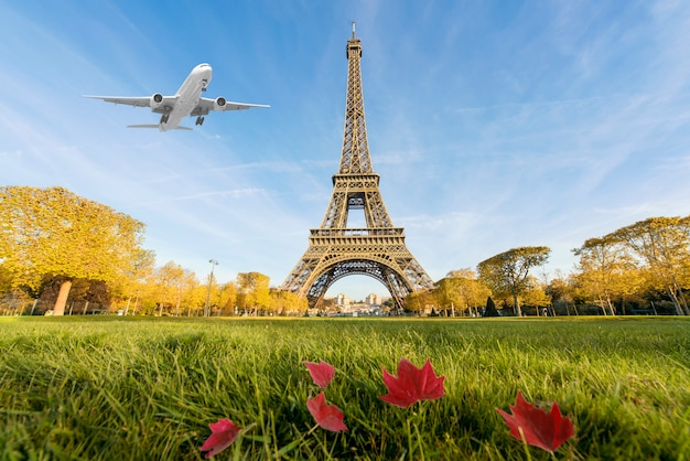 Airplane flying over eiffel tower, paris, france.