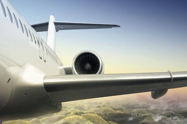 風景の上空を飛んでいる飛行機