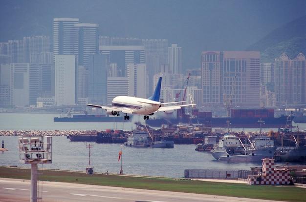Airplane flying above runway