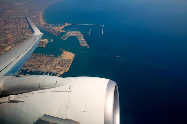 Airplane flying over valencia mediterranean port spain