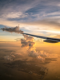 Airplane flying view from inside window at dawn. beautiful horizon. traveling concept