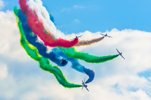 Airplane group fighter against the background of color smoke.