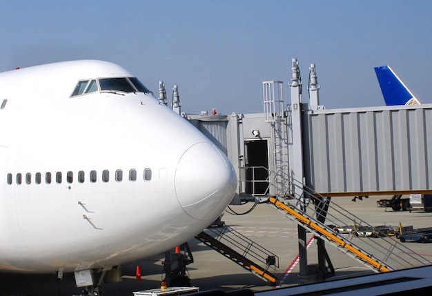 An airplane and a jet bridge at the airport