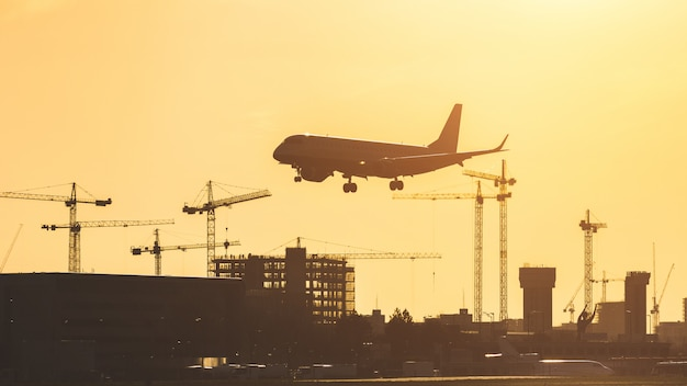 Airplane landing at sunset at london city airport