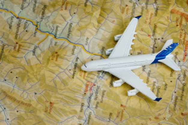 Airplane on the map. travel concept. close up