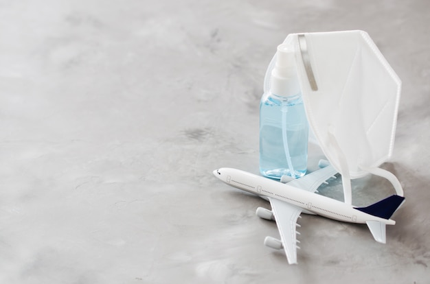 Airplane model, gel bottle spray and face mask