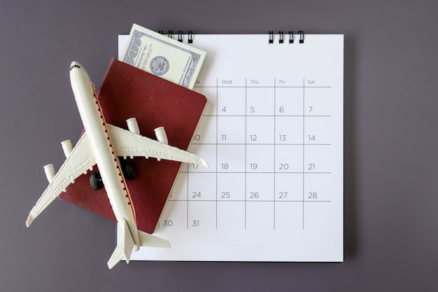 Airplane model with paper calendar. plan for trip