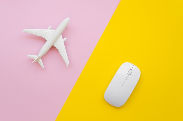 Airplane and mouse on table