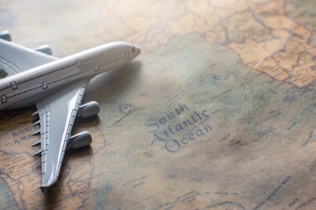 Airplane on paper map for travel adventure discovery image