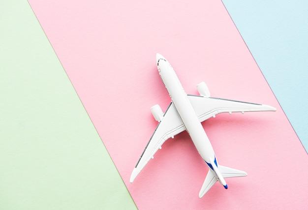 Airplane on pastel background Premium Photo