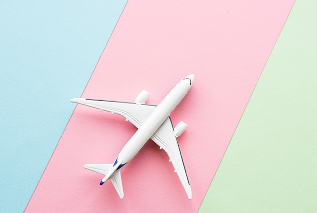 Airplane on pastel background Premium Photo