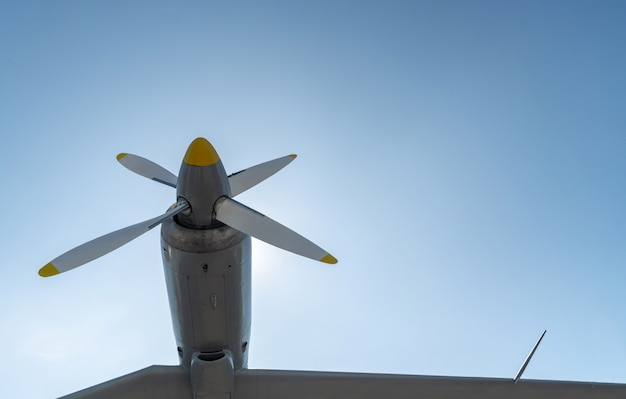 Airplane propeller of military aircraft, copy space. blue sky sunny