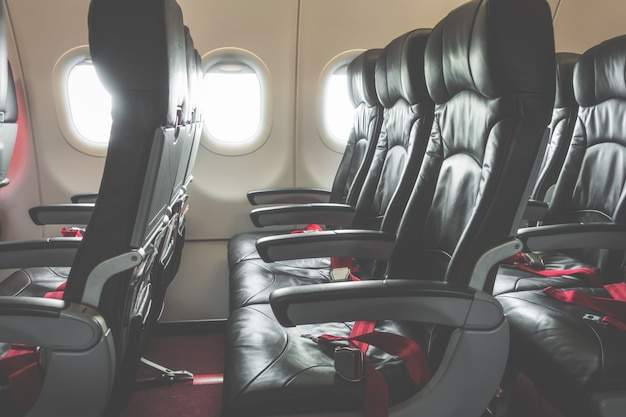 Airplane seats in the cabin .( filtered image processed vintage