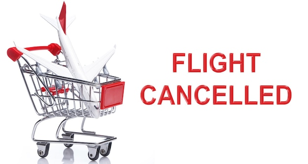 Airplane in a shopping trolley with a message - flight cancelled.