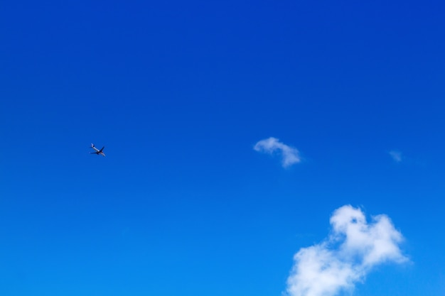 Airplane in the sky on blue sky and white clouds.