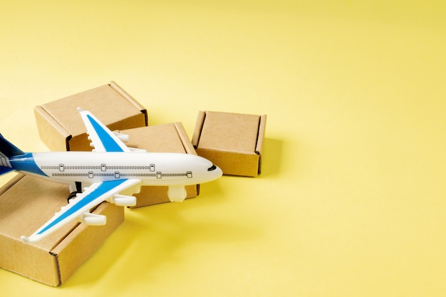 Airplane and stack of cardboard boxes