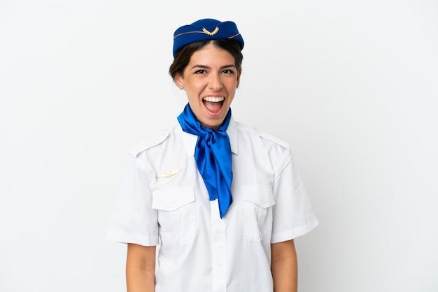 놀란 표정으로 흰색 배경에 고립 된 비행기 스튜어디스 백인 여자
