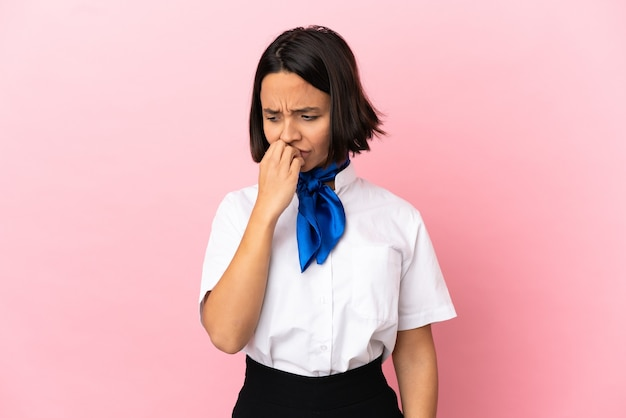 Airplane stewardess over isolated background having doubts