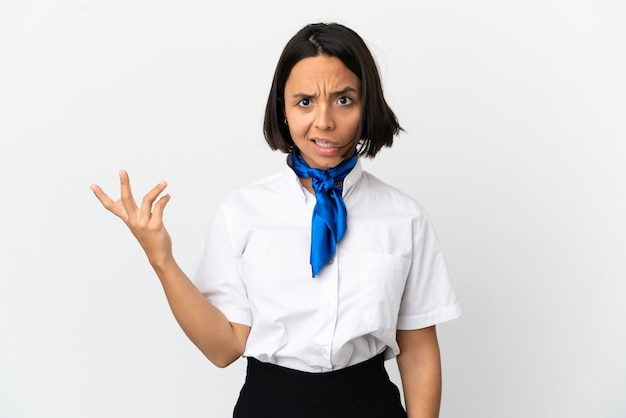 Airplane stewardess over isolated background making doubts gesture