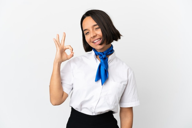 Airplane stewardess over isolated background showing ok sign with fingers