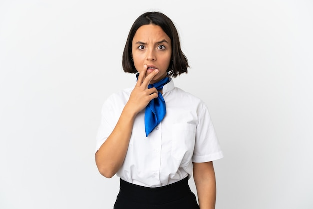 Airplane stewardess over isolated background surprised and shocked while looking right
