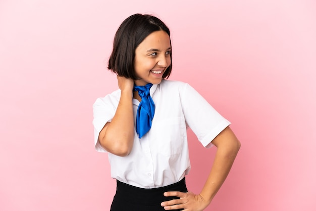 Airplane stewardess over isolated background thinking an idea