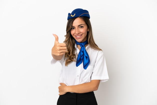 Airplane stewardess over isolated white background with thumbs up because something good has happened