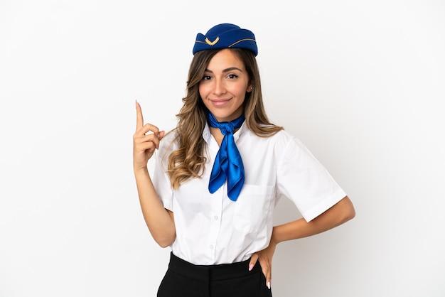 Стюардесса самолета на изолированном белом фоне, указывая указательным пальцем, отличная идея