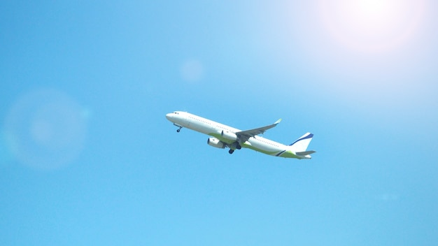Airplane taking off to the blue sky from international airport runway in sapporo hokkaido japan