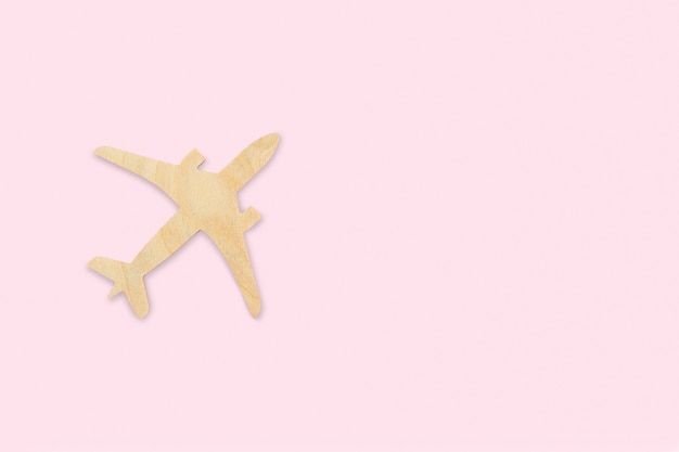 Airplane, toy wooden jet, vacation planning, flight search, ticket booking, travel insurance, dreams, tourism, minimalistic