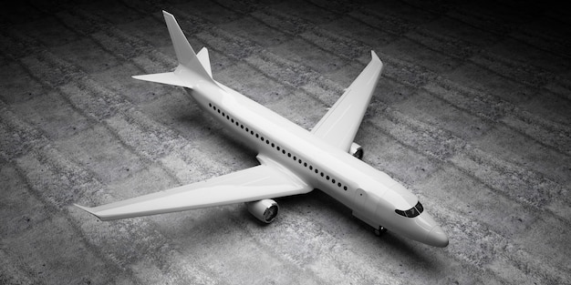 Airplane waiting on concrete floor at hangar
