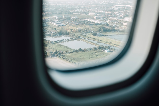 Airplane window with city view