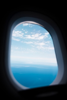 Airplane window with sky and sea lanscape