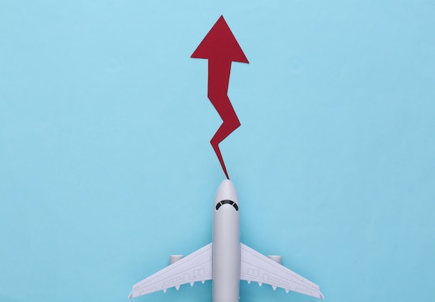 Airplane with growth arrow on a blue