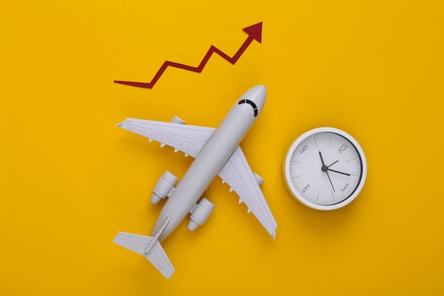 Airplane with growth arrow and clock on a yellow