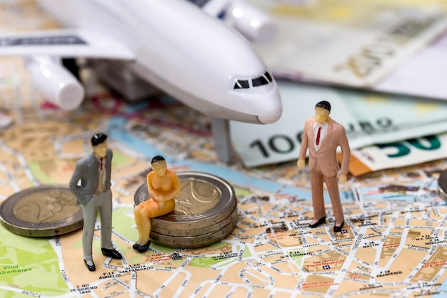 Airplane with map, euros and miniature toy people