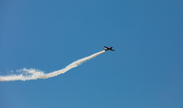 Airplane with a trace of smoke
