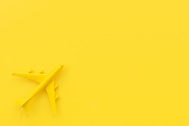 Airplane on yellow background. minimal idea concept, 3d render.