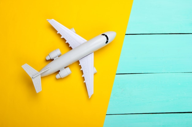 Airplane on a yellow, blue wooden Premium Photo
