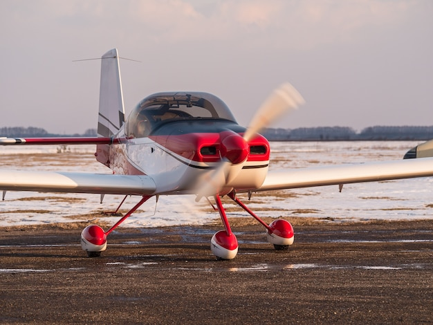 Airplanes parked at a small airport. light aircraft on a private airfield