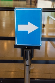 Airport arrow direction sign indoors