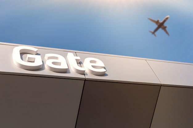 Airport gate letters - way to departure. blurred airplane in blue sky.