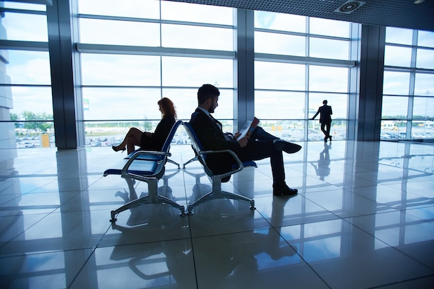 Airport man young partner sitting