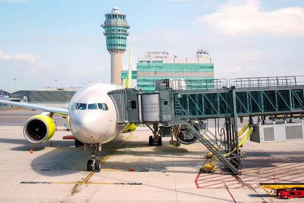 Airport ramp service for for a commercial plane landing at suvarnabhumi international airport.