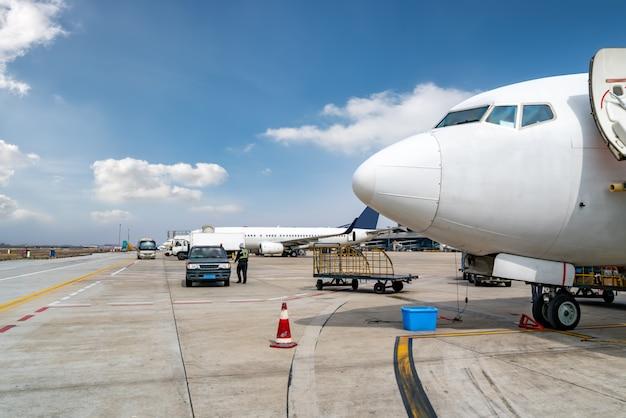 Airport runway apron and passenger aircraft