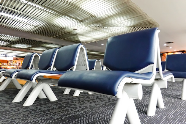 Airport terminal for passenger waiting flights to travel around the world with many seats.